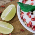 yoghurt-soja-top-view-of-cereals-with-yogurt-and-pomegranate_1156-51